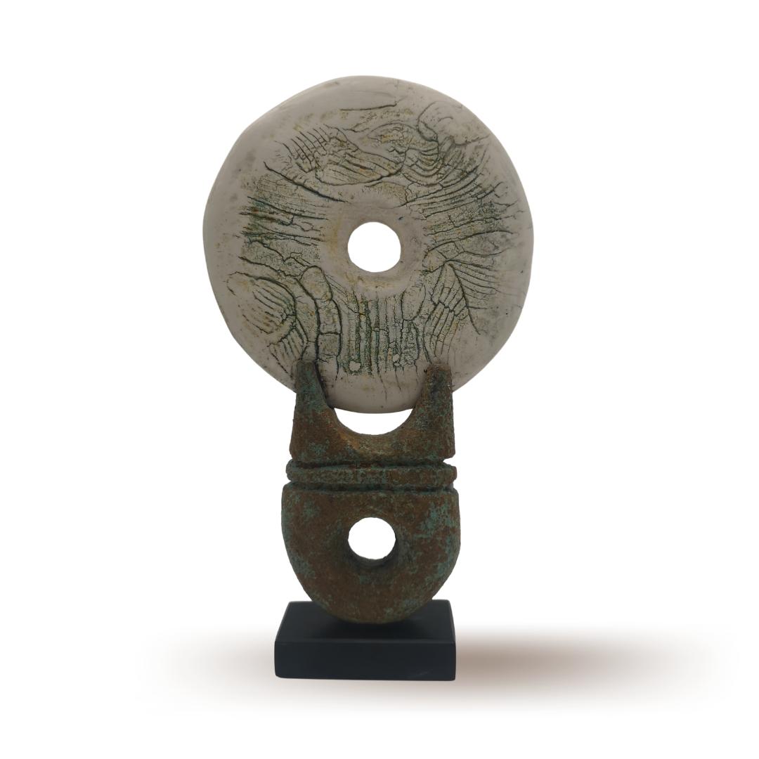Disk on Ceramic Plinth